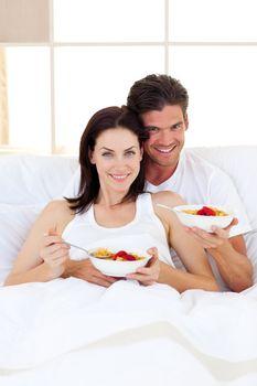 Affectionate couple having breakfast