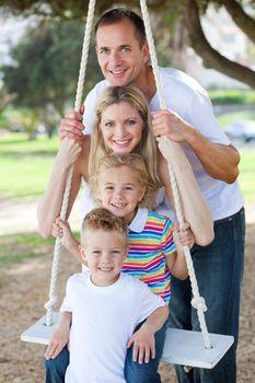 Happy family swinging