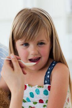 Close-up of little girl taking medecine