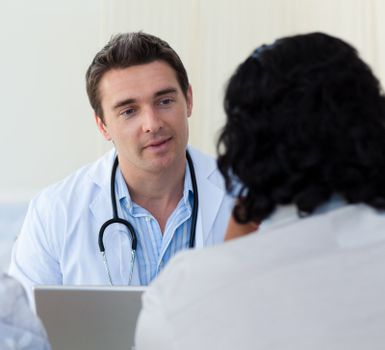 Male doctor explaining diagnosis to a patient