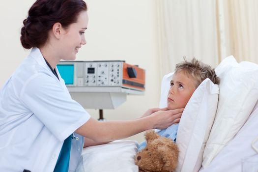 Female doctor examining child throat