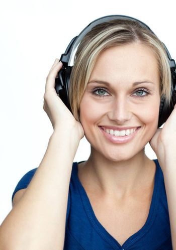 Portrait of happy girl listening to music on headphones