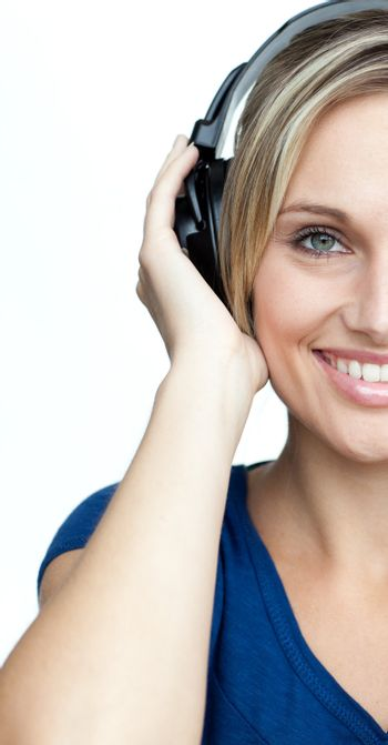Attractive woman listening to music with headphones on