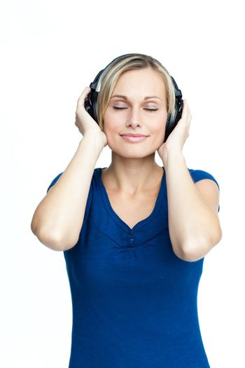 Happy young woman listening to music with closed eyes