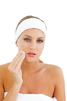 Young woman applying a make-up base