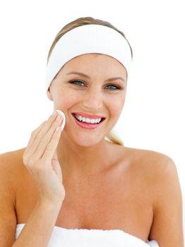 Charming woman applying a make-up base
