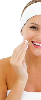 Smiling woman applying a make-up base