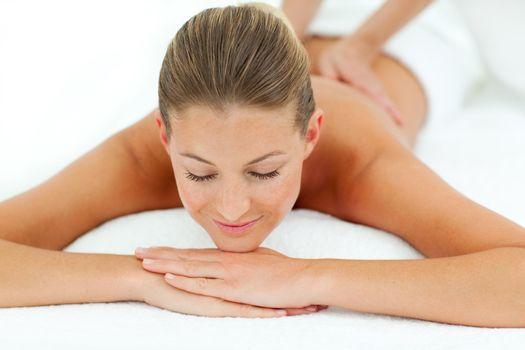 Satisfied woman enjoying a massage