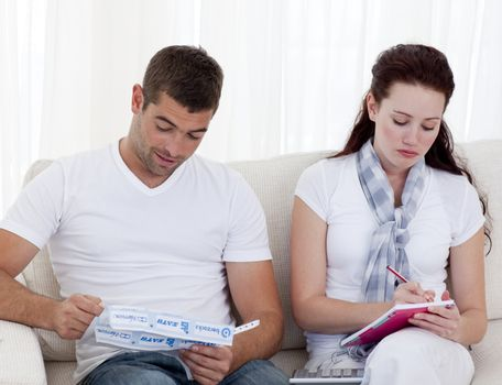Couple studying their budget
