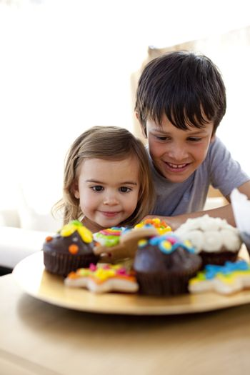 Brother and sister looking at colorful confectionery