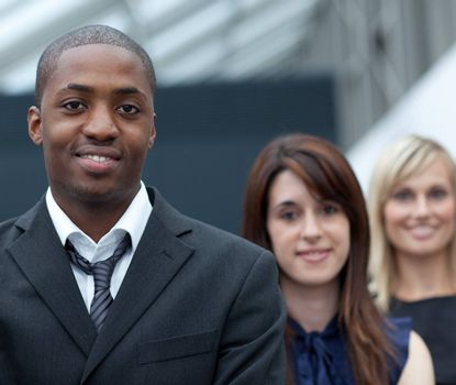 Afro-American young businessman in front of his colleagues