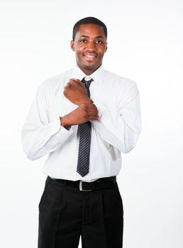 Ethnic businessman corrects a cuff link