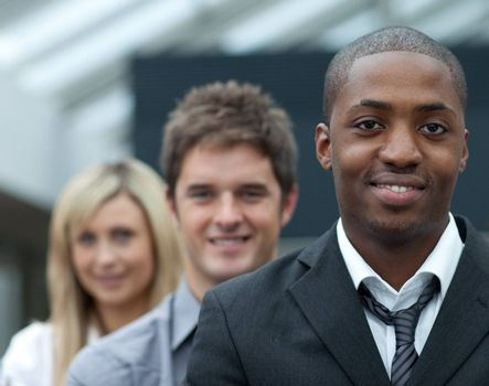 Portrait of an Afro-American young businessman leading his team