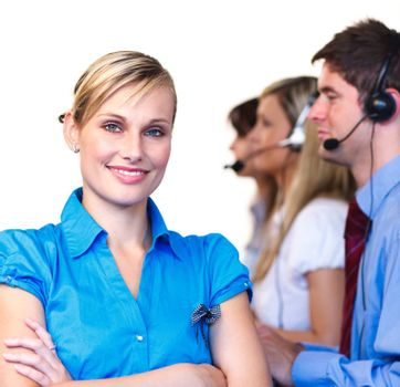 Young businesswoman in front of her team in a call center