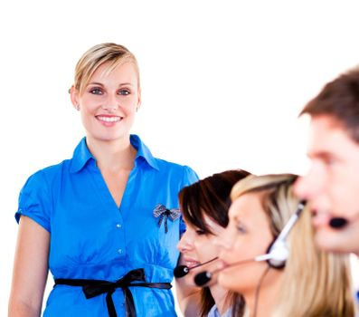 Young businesswoman with her team in a call center