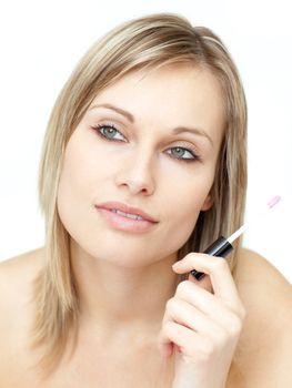 Portrait of a beautiful woman holding a gloss