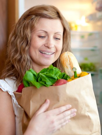 Charming woman holding a grocery bag