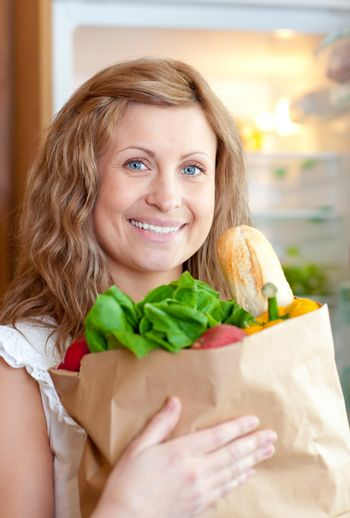 Radiant woman holding a grocery bag