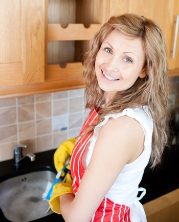 Positive woman doing the dishes