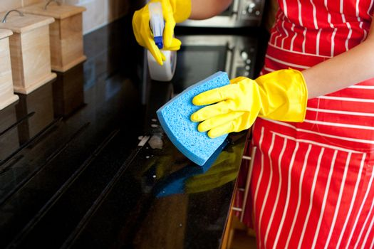 Close-up of a young woman doing housework