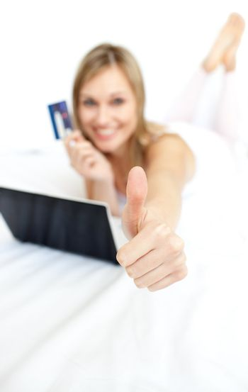 Happy woman with a thumb up shopping on-line