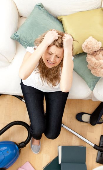 Depressed young woman doing housework