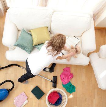 Blong young woman doing housework