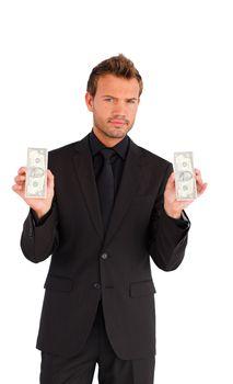 Handsome businessman with bundle of money