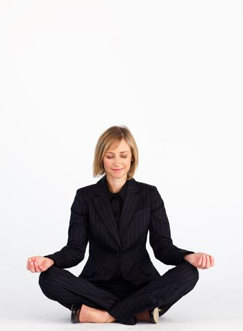 Businesswoman doing yoga with copy-space