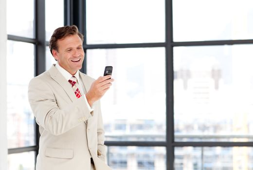 Mature businessman texting with copy-space