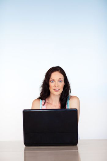 Woman concentrated on her laptop with copy-space