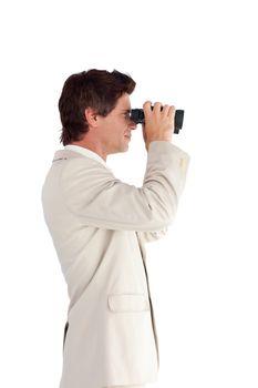 Good-looking businessman using binoculars