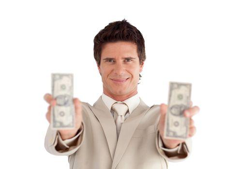 Good-looking businessman showing dollars