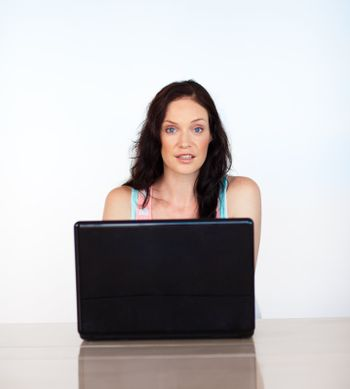 Woman concentrated on her laptop