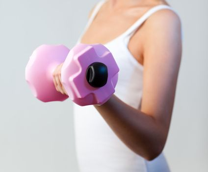 Healthy woman trained with weights focus on weights