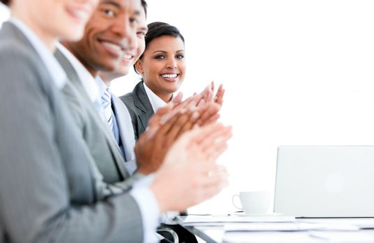Close up of a multi-ethnic business team applauding a presentation in the office
