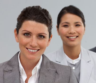 Attractive Business people standing in a line smiling at the camera