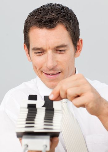 Attractive businessman consulting a card holder