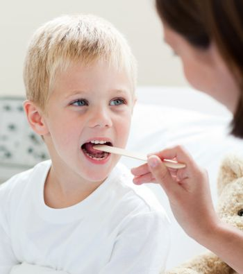 A doctor examining a child's throat