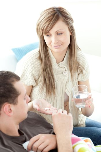 Bright woman give medicine to her husband her husband