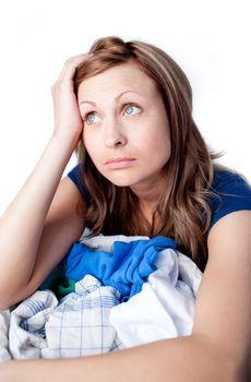 Upset woman doing laundry