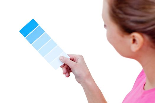 Caucasian woman choosing a color to decorate her house