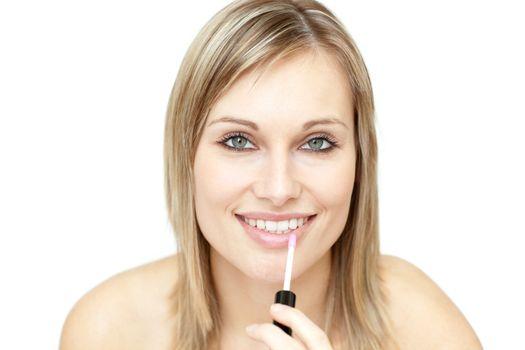 Beautiful woman putting gloss