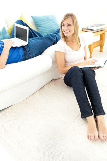 Smiling couple having free time in the living-room