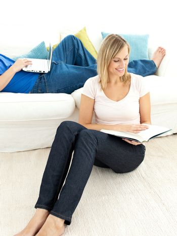 United couple having free time in the living-room