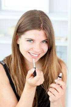 Portrait of a beautiful woman use gloss