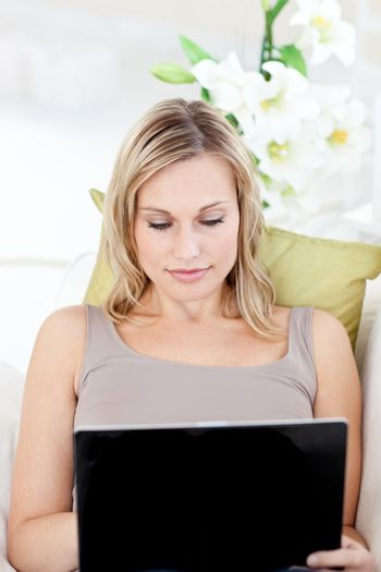 Concentrated woman with a laptop
