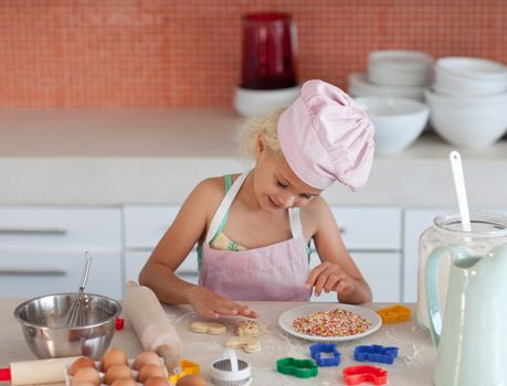 Concentrated girl baking