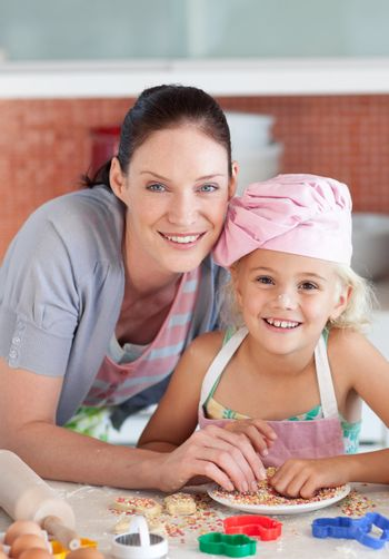 Happy mother and daughter  in the kitchen