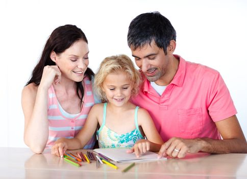 Father and mother drawing with her daughter at home